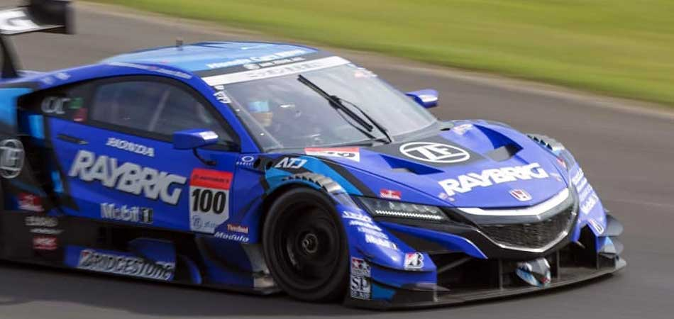ZF Motorsport partner Honda with GT500 Super GT race car on the racetrack.
