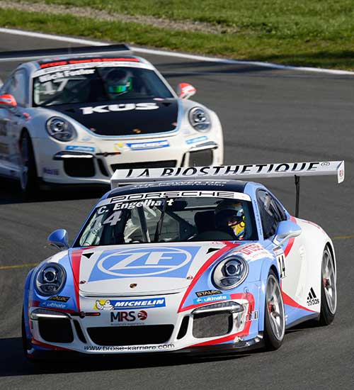 Porsche 911 duel on the race track at the Porsche Supercup.