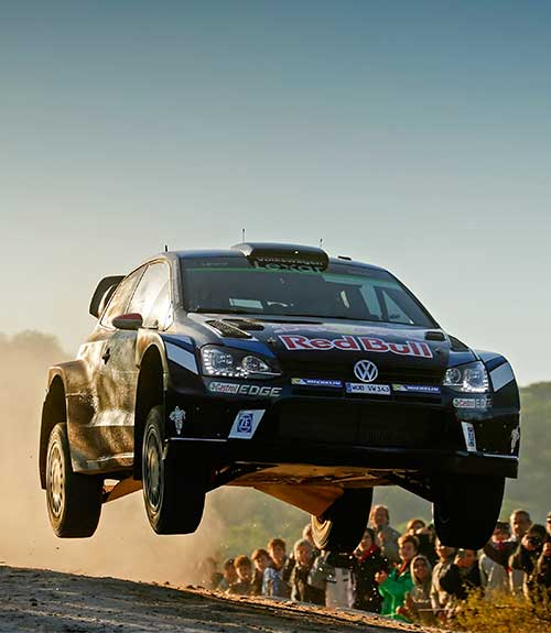 VW Polo R WRC with SACHS shock absorbers and clutch on a gravel road.