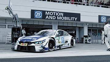 BMW DTM touring car in front of the ZF Motorsport pit lane